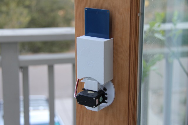 photo of a DIY NFC door lock found on Instructables.com, with all the electronics & parts on the interior side of the door